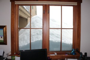 Snow pile by the back door from the office window